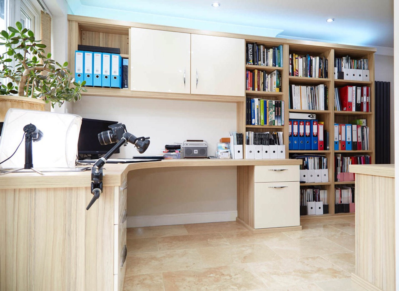 Case study showing curved desk and overhead cabinets in home office