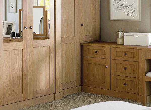 Fitted wardrobe doors designed to accommodate a closet and drawers.