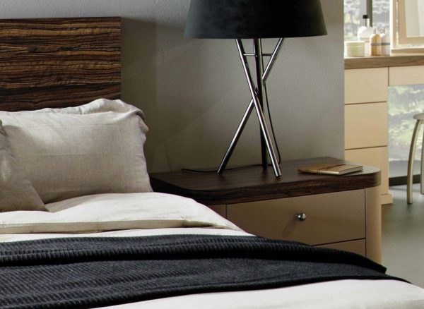 Curved profiles on bedside drawers