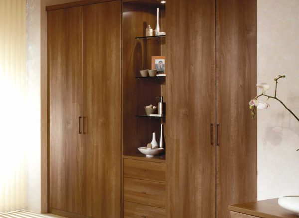 Fitted walnut wardrobes with glass display units