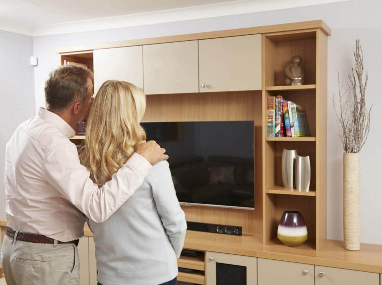 Couple looking at Strachan fitted furniture