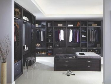 Dressing room with fitted wardrobes and central island in Aura Black