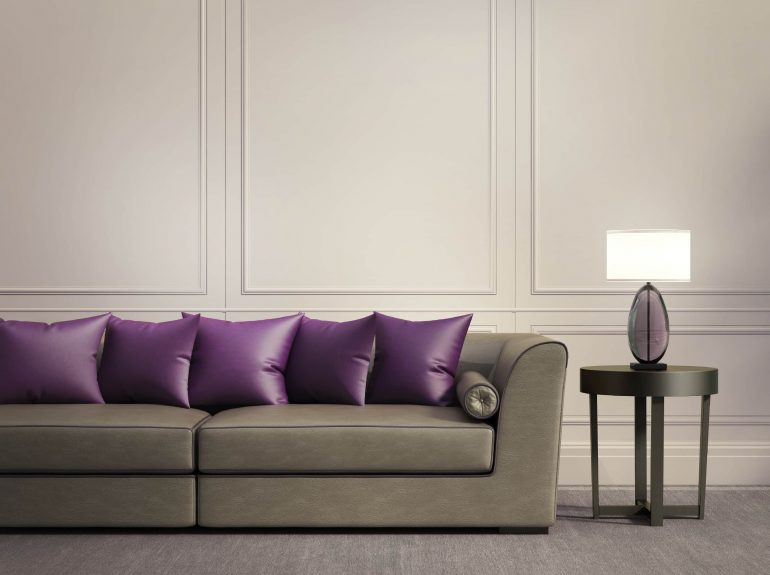 Grey sofa with statement purple scatter cushions
