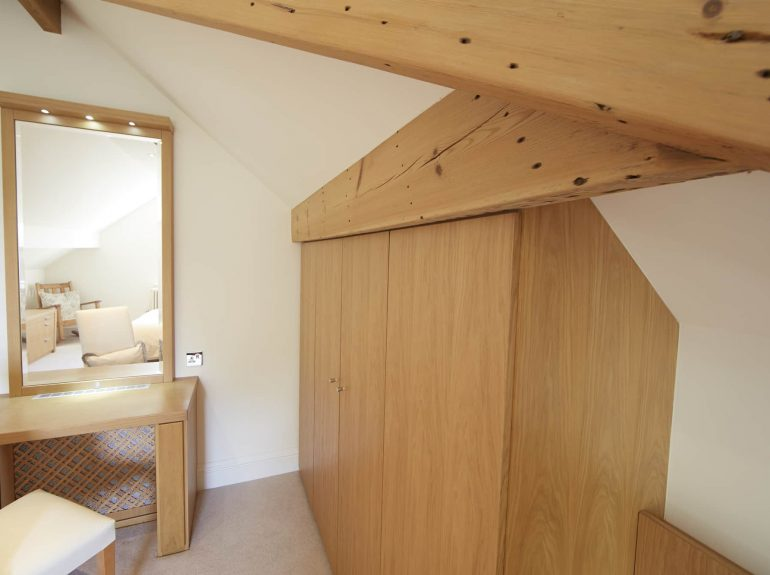 Strachan wardrobes fitted against slanting ceiling