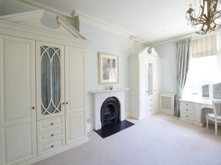 Traditional fitted furniture in master bedroom