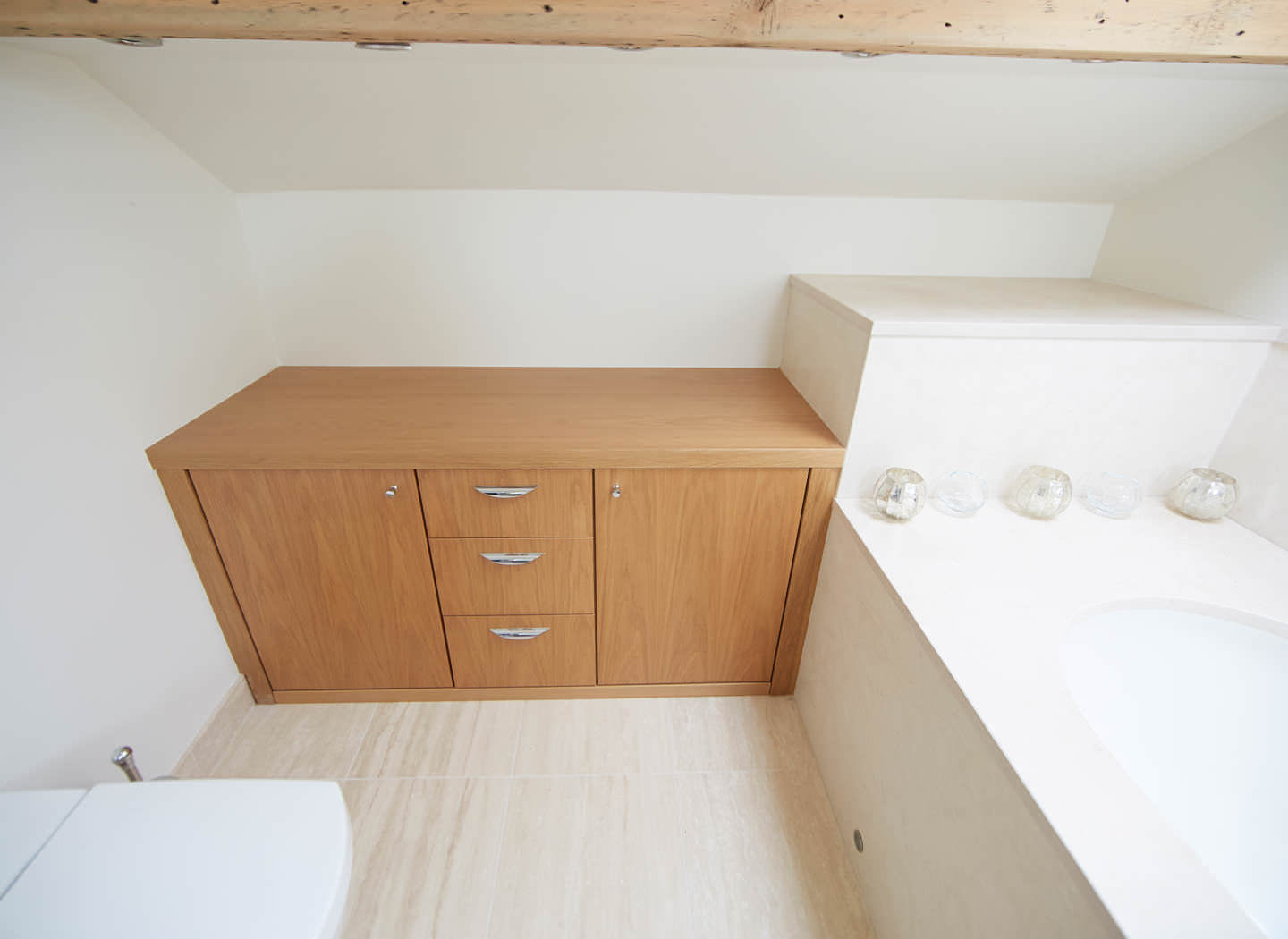 Case study showing fitted bathroom cabinets in loft conversion