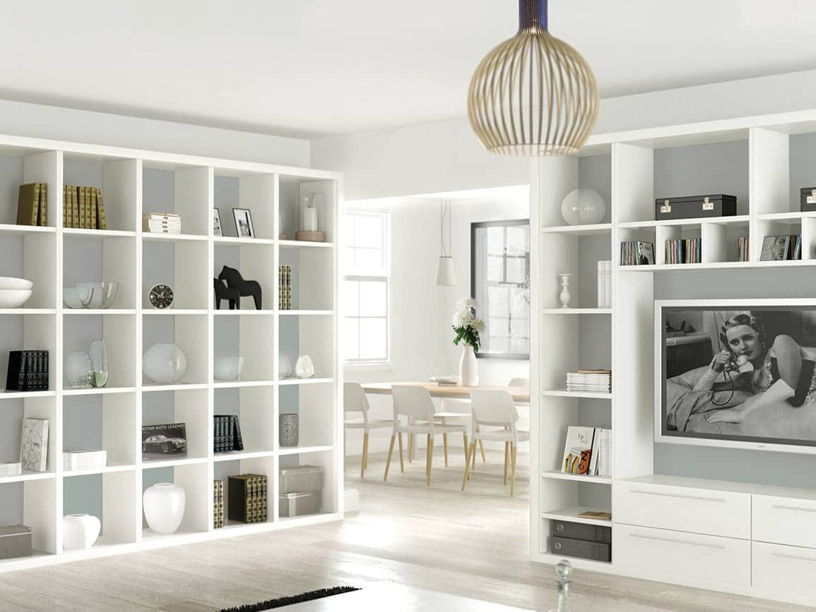 Fitted bookshelves with a pale blue backing