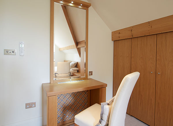 Case study showing vanity table and mirror in loft conversion