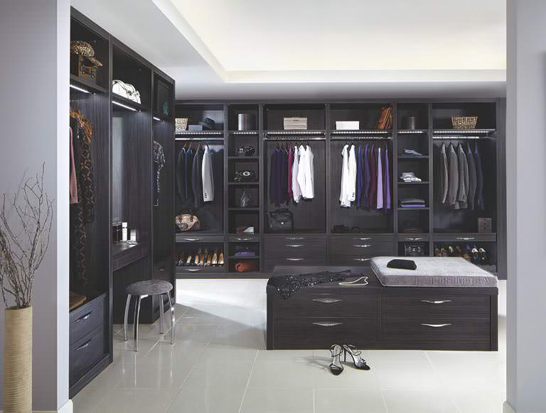 Fitted dressing room in dark wood