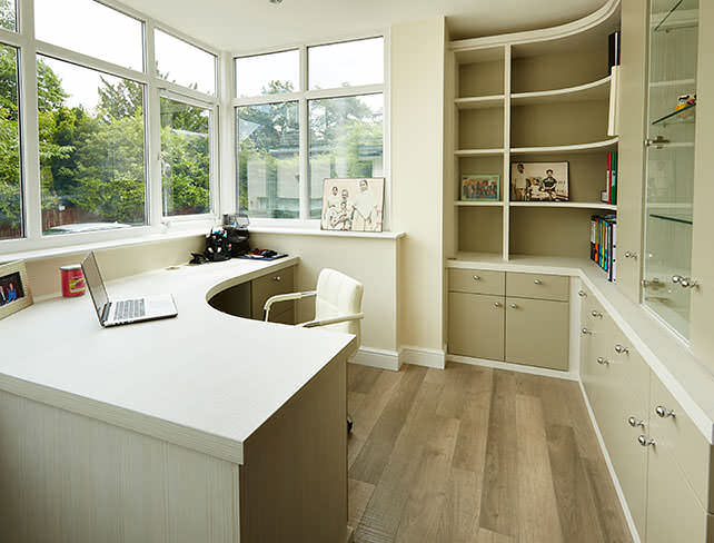 An L-shaped desk fitted into a home office.