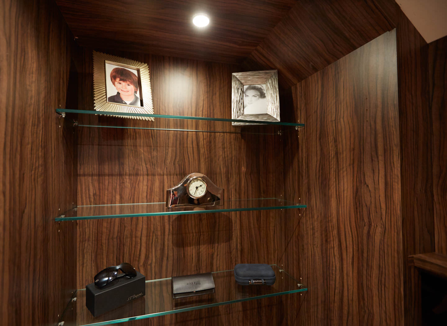 Case study showing glass shelving detail in walk in wardrobe