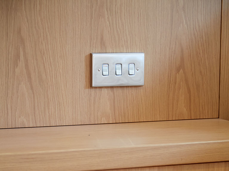 Integrated light switch on Optima headboard