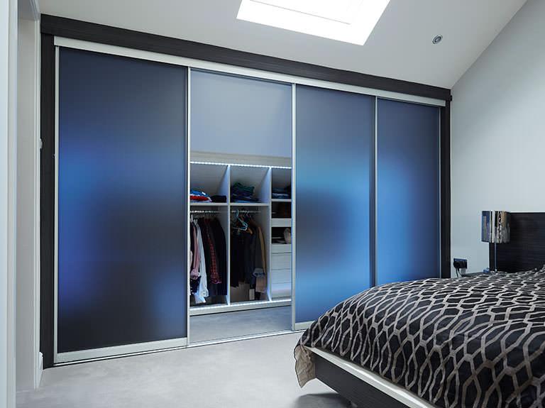Case study showing sliding wardrobe doors with LED lights