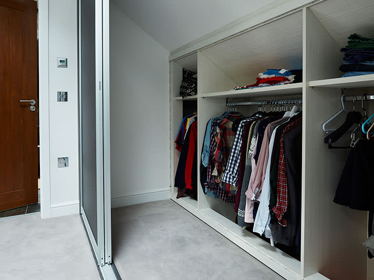 Case study showing storage behind sliding wardrobe doors