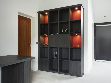 Fitted storage cabinets in deep red and Aura finish