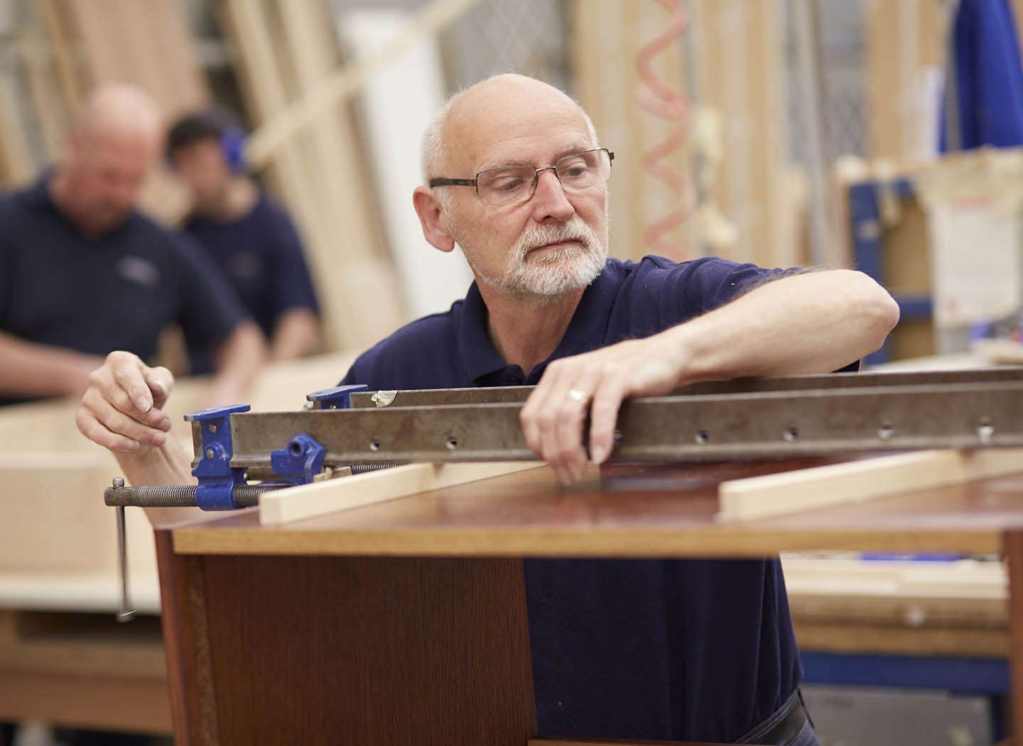Experienced craftsman working on your furniture