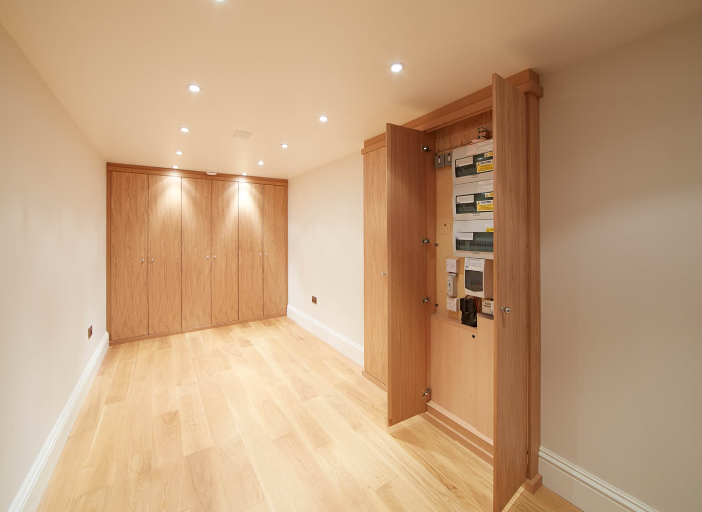 Case study showing meters cupboard in basement conversion