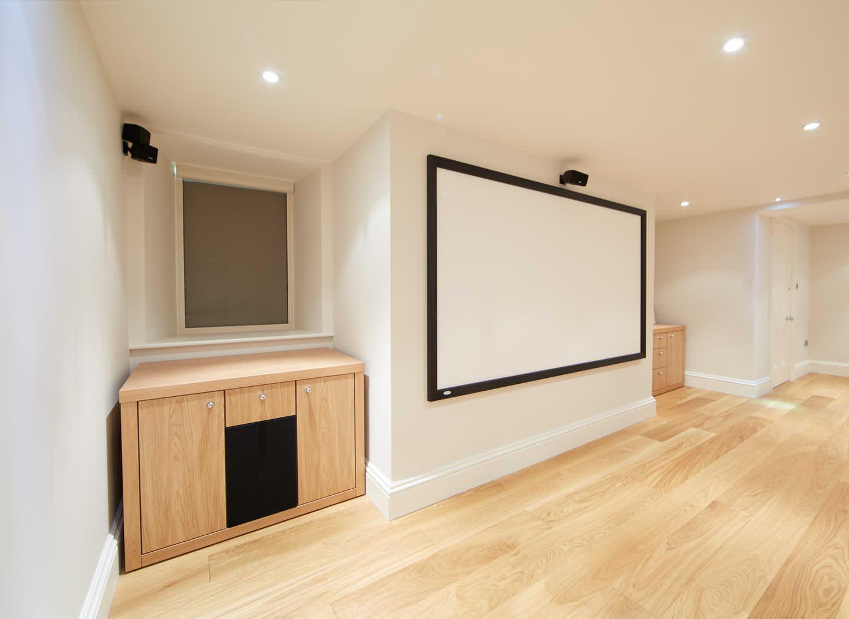 Case study showing speaker cabinet in home cinema basement conversion