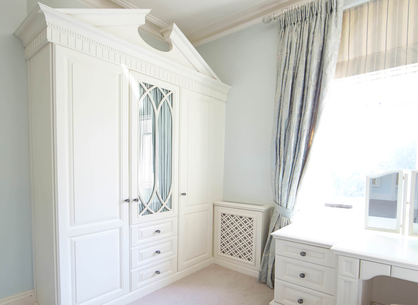 Case study showing wardrobe, desk and radiator cover in bedroom