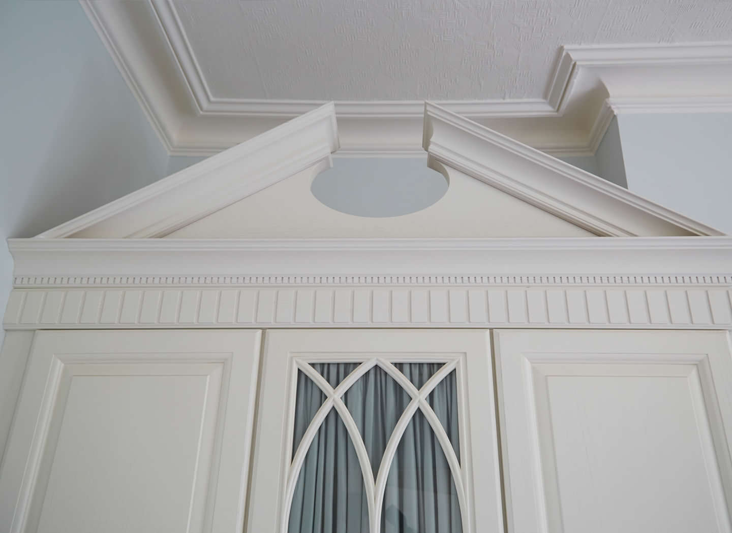 Case study showing traditional wardrobe pediment