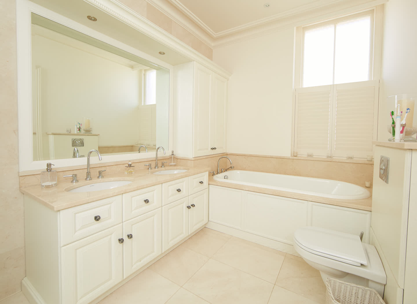 Case study showing fitted cabinets in bedroom en suite
