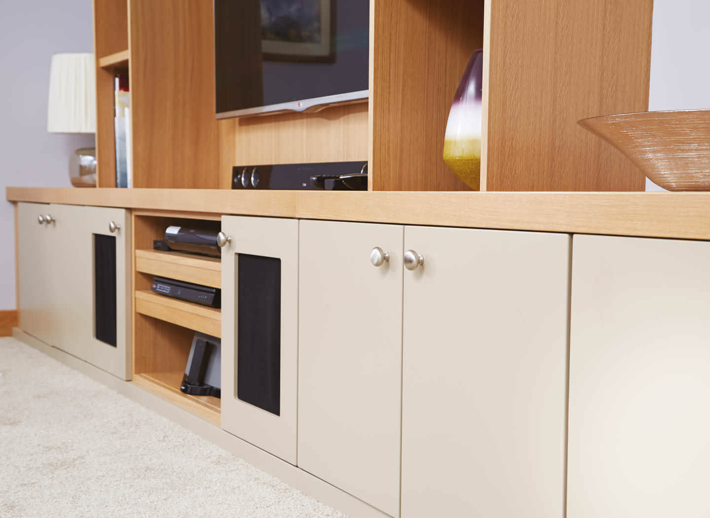 Case study showing wall to wall cabinets in lounge