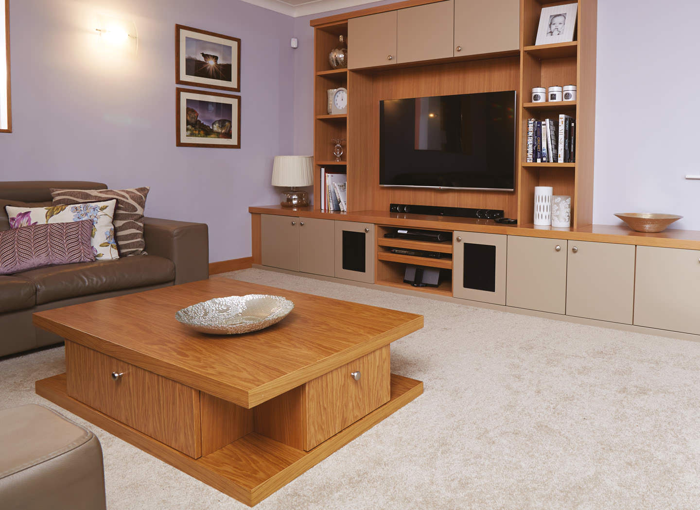 Case study showing coffee table and cabinets in lounge