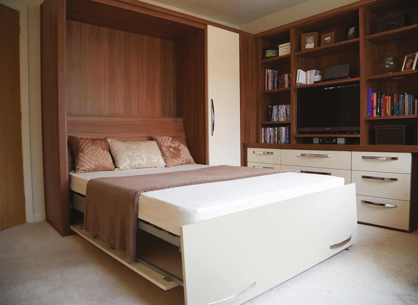 bed in office. case study showing pulled down wall bed in bedroom office