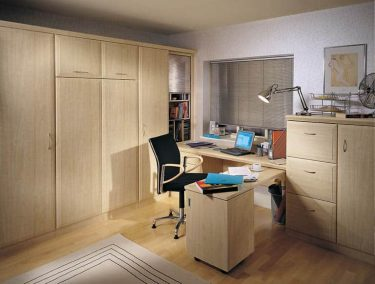 Fitted study bedroom with hidden bed and folding desk