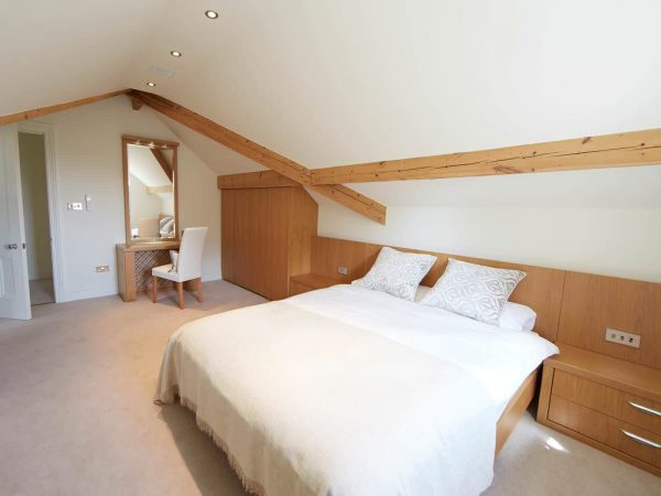 Attic bedroom with Beech headboard and wardrobes
