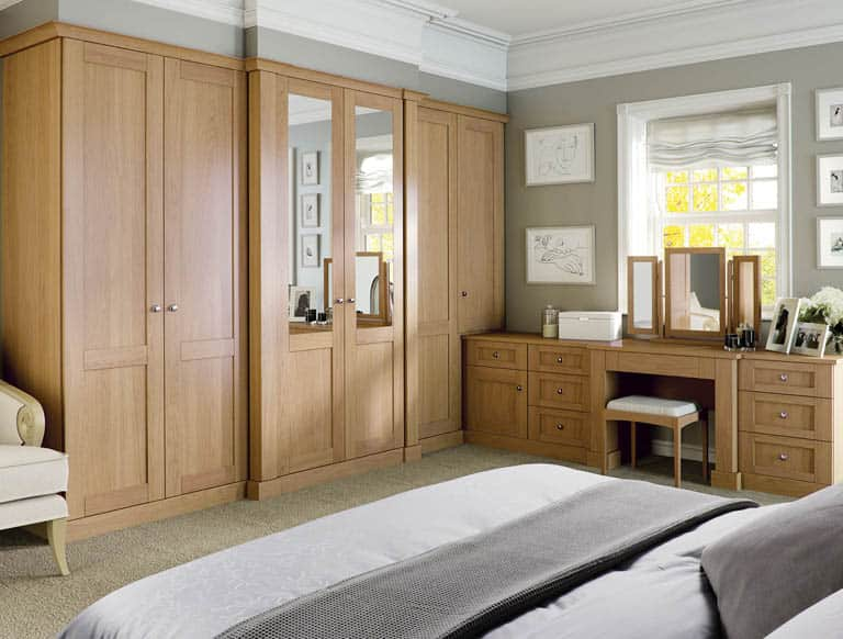 Verona fitted bedroom wardrobe and dresser finished in English oak