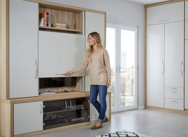 Woman sliding the pull up tv panel