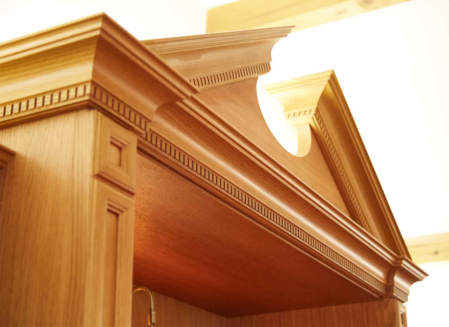 Fitted bookcase pediment detail