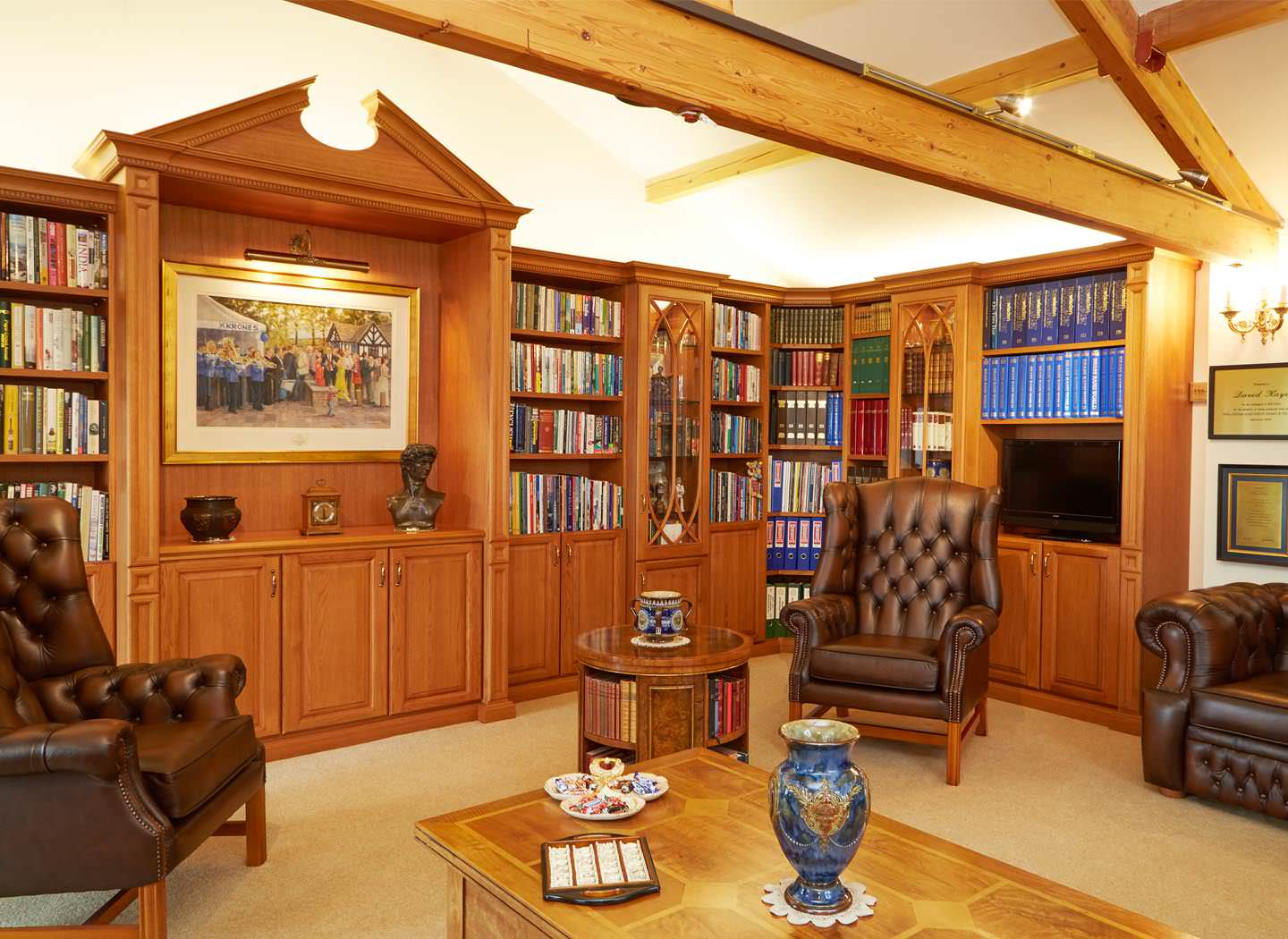 Fitted private library with spot lighting