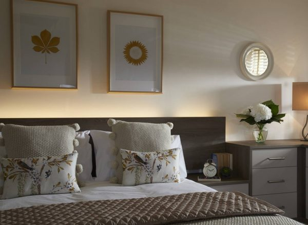 Contemporary bed headboard with concealed L.E.D. lighting