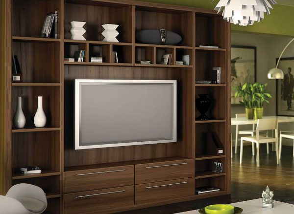 Fitted bookshelves with space for a floating tv