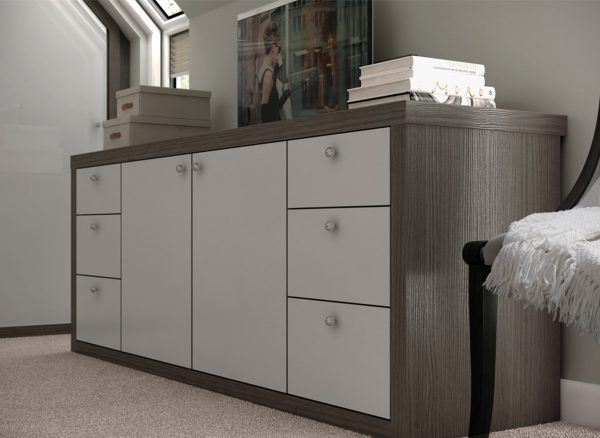 Low level bedroom storage shown with contrasting finishes