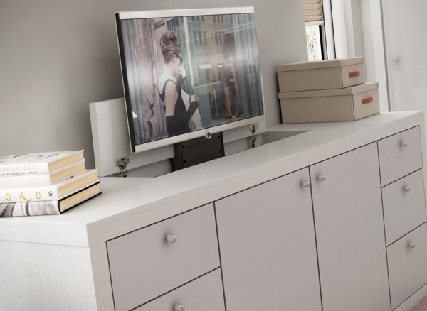 Bedroom storage with integrated pop-up television