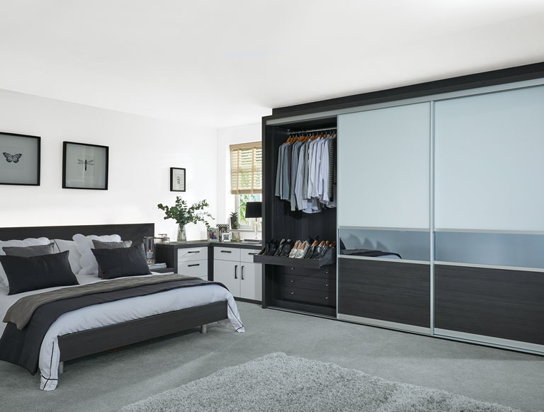 Contemporary bedroom with fitted sliding doors