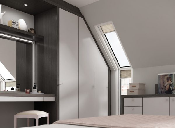 Contemporary style wardrobe fitted expertly to a sloping bedroom wall