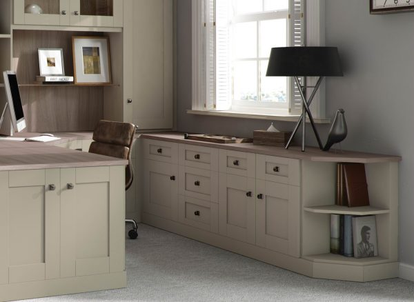 Fitted cabinets and drawers in sage green