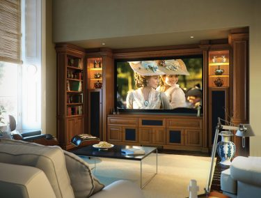 Fitted home cinema in Shades of in a mellow oak finish