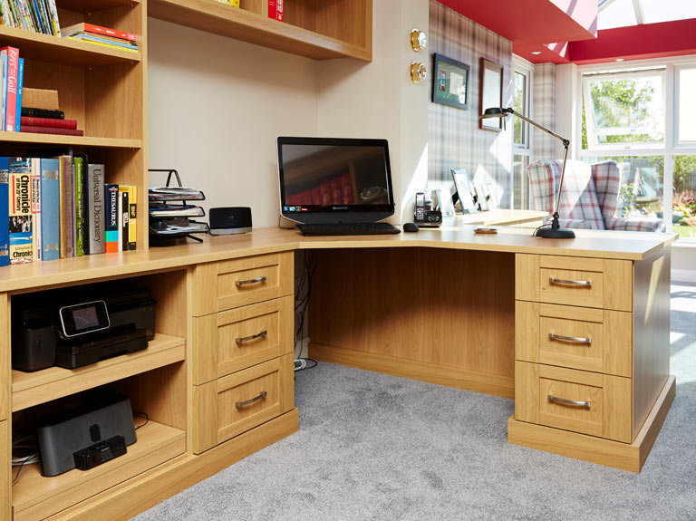 Fitted home office peninsular desk with bespoke bookshelves