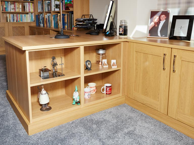 Home office with open ended display cabinets