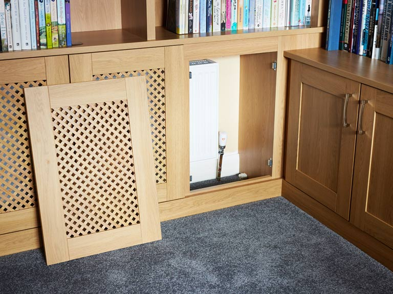 Bespoke radiator covers to match built in bookcases