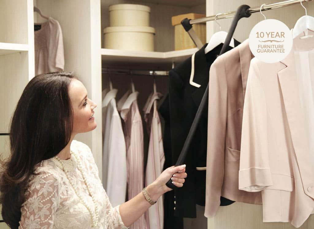 Walk in wardrobe with easy to access pull out hangers
