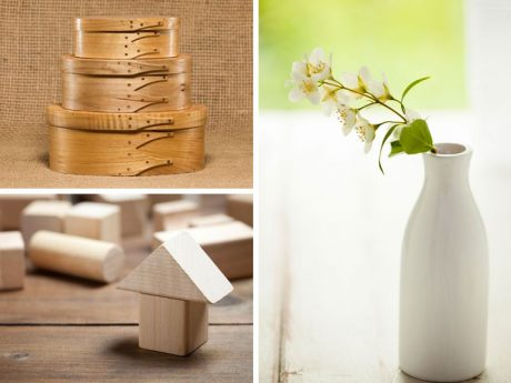 wooden stacked boxes, simple wooden toys and plain ceramic vase with white flowers