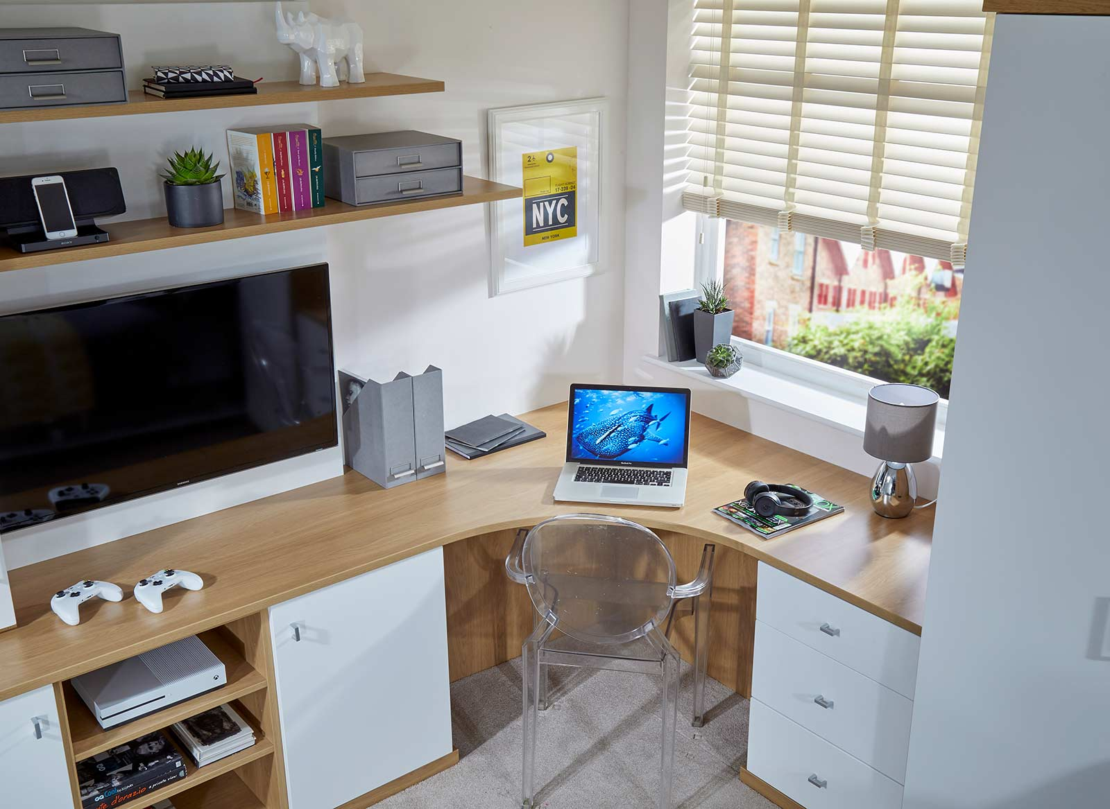 A computer desk fitted to the corner of a study bedroom