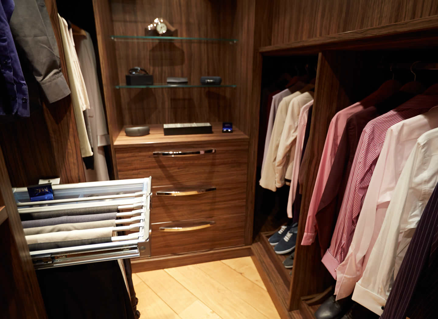 Case study showing full depth storage in walk in wardrobe