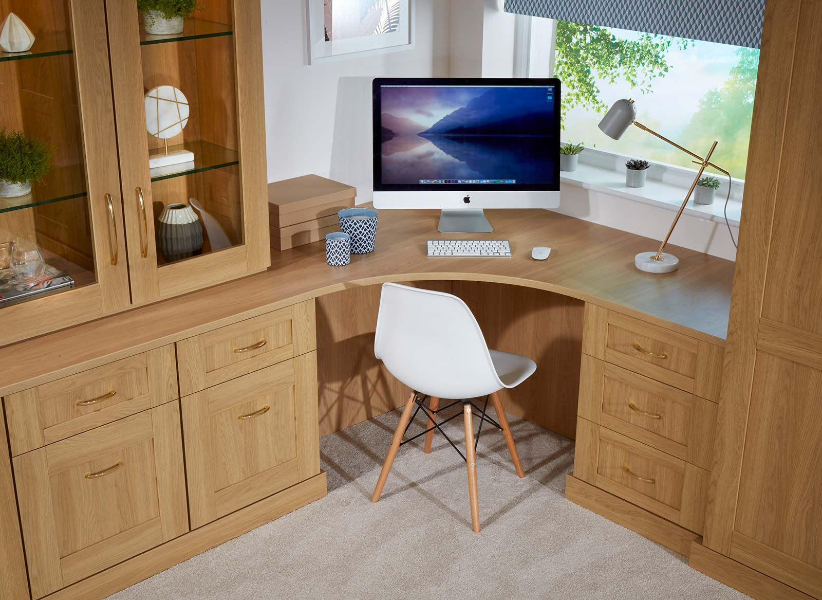 A perfectly fitted wooden corner desk in a home office